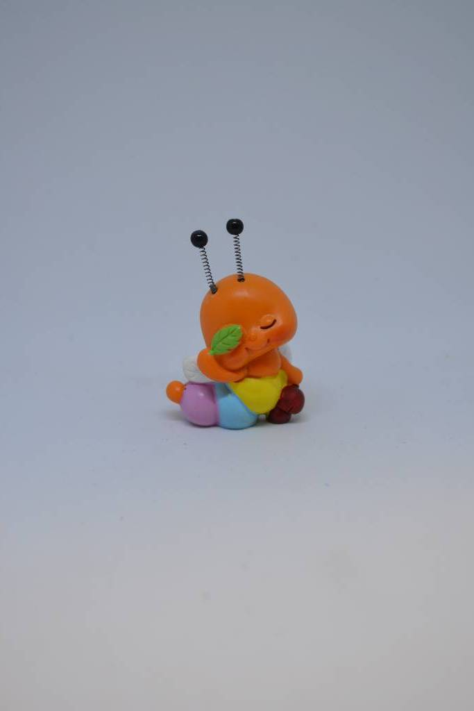 Figurine de baptême chenille orange festival de la dragée